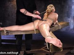 Double dildo penetration for gorgeous blonde slave in bondage punishment