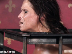 Caged up brunette slave has to endure harsh and rough deepthroating punishment