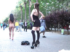 Gagged slave in collar walks around the street in her beautiful birthday suit