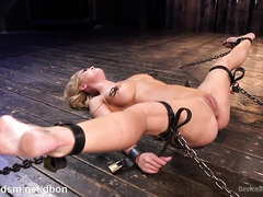 Chained up slave surrenders her big tits and succulent cunt to master