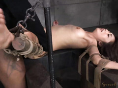 Skinny Asian moans wildly from black master's bondage punishment