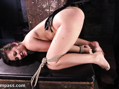 Stimulating bounded brunette slave's twat with rough fingering and beating