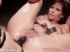 Mistress showed mature redhead slave no mercy during their wild lesbian play