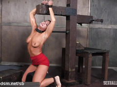 Pretty brunette slave surrenders after riding on a powerful sybian machine