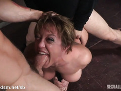 Big boobs brunette slave gets her wet pussy defiled by two horny man rods