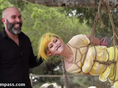 Babe is humiliated in public while being bounded and suspended from a tree