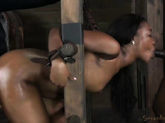 Two masters torment hot ebony's tight beaver with their demanding male rods