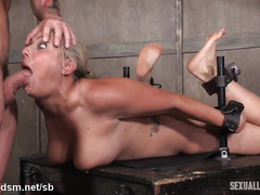 Hogtied big tits blonde suffers from excessive deepthroating from two masters