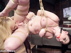 Dark-haired slave experiences wicked strapon thrashing from hot blonde mistress