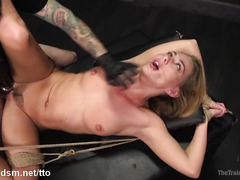 Sexy brunette slave rides on a sex toy while giving non-stop deepthroating