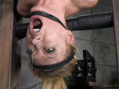 Voluptuous blonde gives lusty deepthroating while being bounded upside down