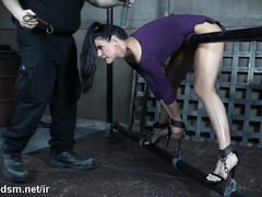 Mature slave suffers from painful flogging with an ass hook inside her anal
