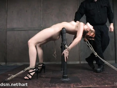 Punishing brunette slave's pussy with sex toys until it is totally drenched