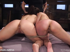 Two breathtakingly beautiful slaves surrender their tight butt holes to master