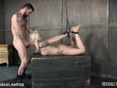 Hogtied blonde slave experiences grueling deepthroating from horny masters