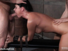Brunette chokes with cock during rough BDSM threesome