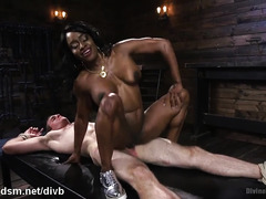 Muscular ebony chick plays dominant with submissive white guy