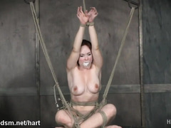 Busty redhead gagged and made to endure severe BDSM