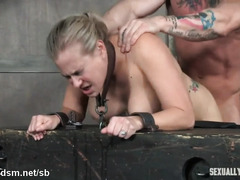 Naked blonde endures harsh BDSM sex with couple