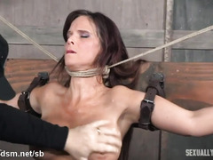Busty milf chokes with cock during rough BDSM play