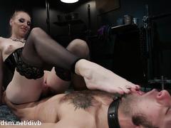 Dominant blonde works hard on slave's butt hole