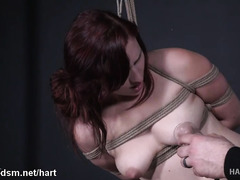 Submissive redhead endures a lot of pain in harsh bondage XXX