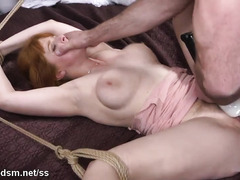 Stunning redhead roughly fucked while fully stranded in ropes