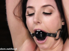 Submissive brunette with huge tits in rough BDSM porn scenes
