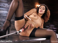 Curly haired ebony slut takes good care of her fat pussy