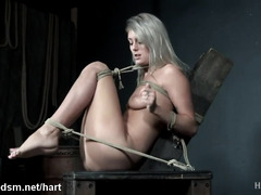 Teen blonde endures a rough treatment in scenes of BDSM porn