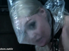 Restrained blonde gets chained, asphyxiated and anal fucked