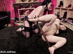 Lesbians sharing brutal femdom moments in scenes of BDSM