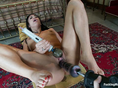 Hannah White takes on a variety of thrusting dildos in all her holes