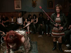 An unfortunate redhead is passed around like a toy in this crowded bar