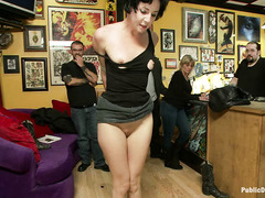 A filthy whore has her pale body ravished at a shady tattoo parlor