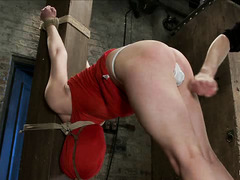 Coarse rope holds this pretty blonde still while her soft body is shocked