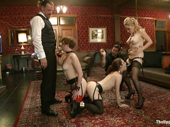 Two gorgeous slaves are made to service their male and female masters