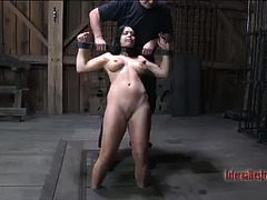 A stunning babe locked up in metal restraints is made to cum over and over