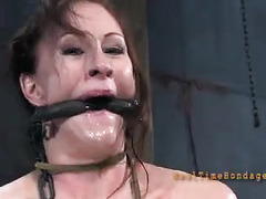 A pretty redhead experiences pleasure and pain during her bondage session