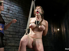 Felony moans and writhes as electricity is used to torment her skin