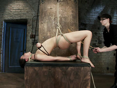 Bryn Blayne is held tight by rope during this painful tit torture