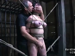 Dark-haired mama made to scream as she's tied and caned until she bruises