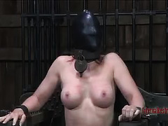 A redhead is put through the paces by a cruel and punishing Dom