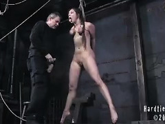 A young slut is suspended by her tied tits and fucked until she moans