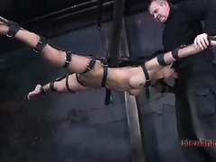 An Asian princess squeals as her body is assaulted by her Dom's toys