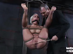 An eager, inexperienced blonde submits herself to a Dom's taxing punishments