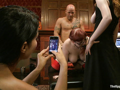 Red-headed slave is dominated by five cruel and abusive Masters