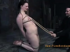 A brunette is encased in tape and made to cum so hard that she squirts