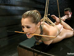Kristina Rosa continues slave training with whips, canes and clamps
