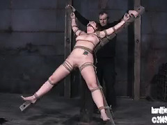 A pretty chick is bound, whipped, caned and fucked by an older Master